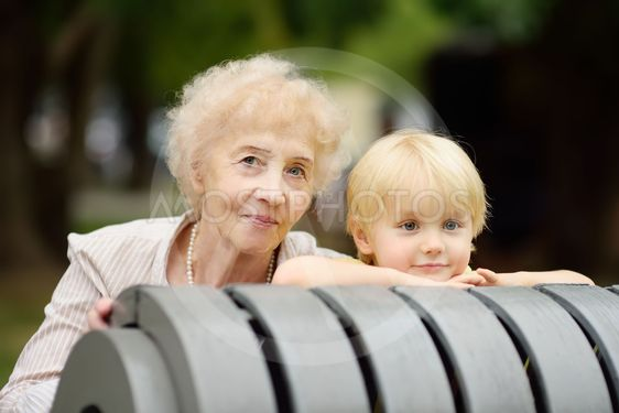 Beautiful granny and her little grandchild together in park