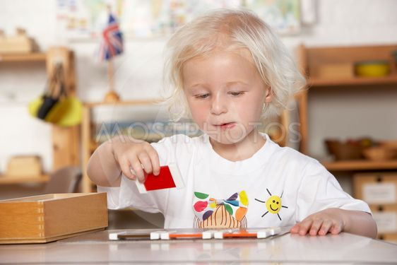 Adult Helping Young Children at Montessori/Pre-School