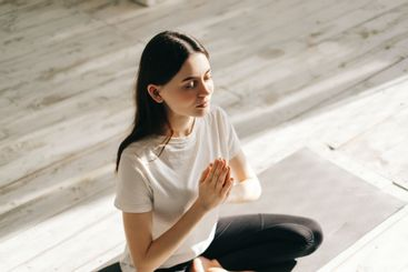 Beautiful brunette fitness woman meditate, doing yoga...