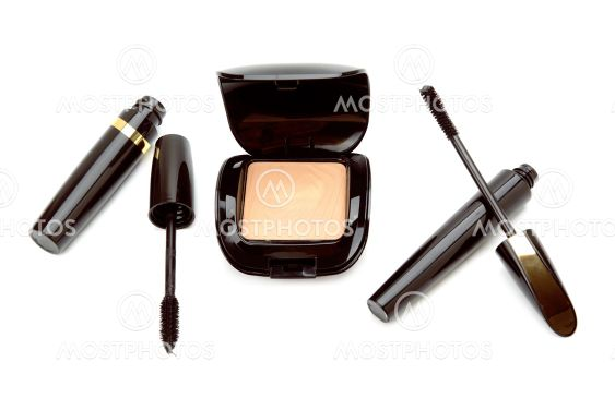 Cosmetic powder of flesh tint and mascara isolated on...
