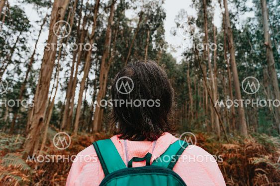 Super close up of the back of an old woman in front of a...
