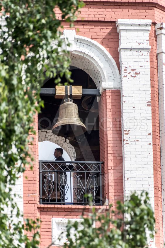 The City Of Birsk. The bell ringer in the belfry of Holy...
