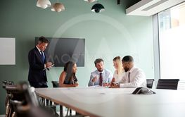 Group Meeting Around Table At Graduate Recruitment...