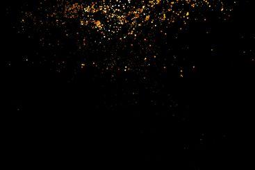 Golden sparkles on black background