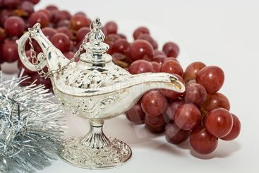 Aladdin's magic lamp and red grapes