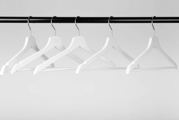 slider black fashion coat rack with empty white hangers