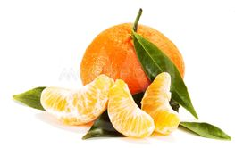 Ripe mandarin with leaves close-up