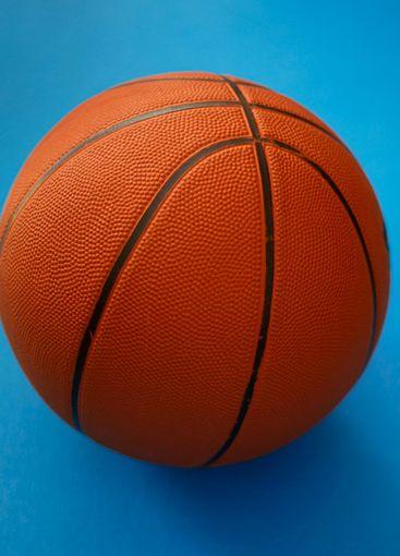 Closeup on basketball on a blue background
