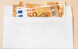 several fifty euro notes in envelope on table