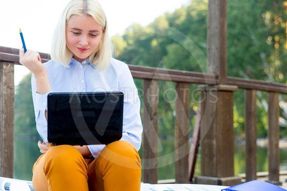 Businesswoman working on a beach