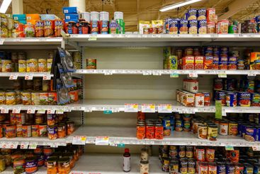 Empty grocery store shelves of canned goods  before a...