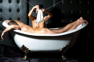Young nude couple in bathtub