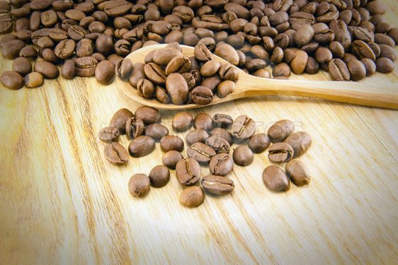 Coffee beans on vintage wooden board
