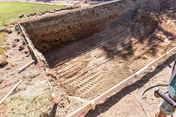 Freshly Dug Hole In Yard Preparing For Swimming Pool...