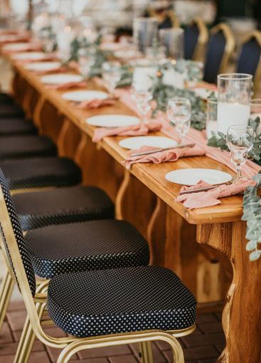 Wedding table setting in a restaurant decorated with...