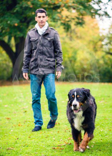 Man walking his dog in fall park