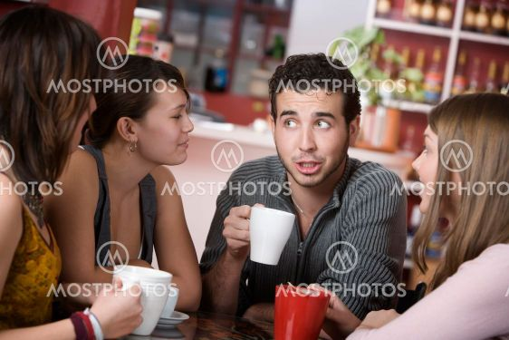 Handsome Young Man Surrounded by Women