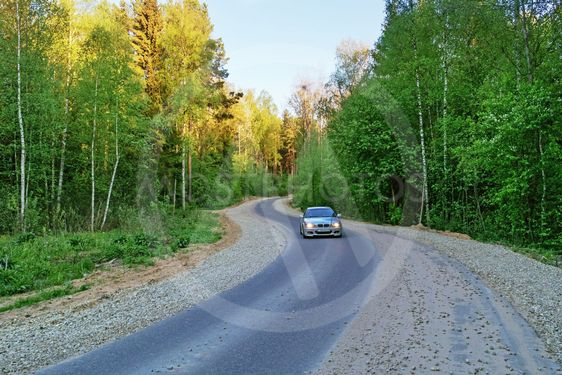 On asphalted rural road.