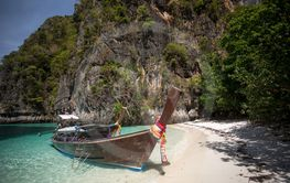 Thai traditional wooden longtail boat in Maya bay