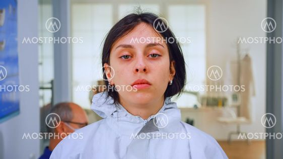 Exhausted nurse looking on camera without face mask