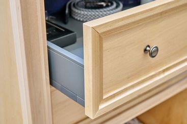 Wooden wardrobe. Open drawer with men's belts
