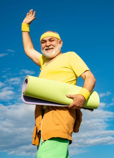 Funny sporty old sportsman finished his work out. Senior...