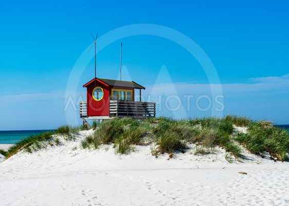 Red house on the beach