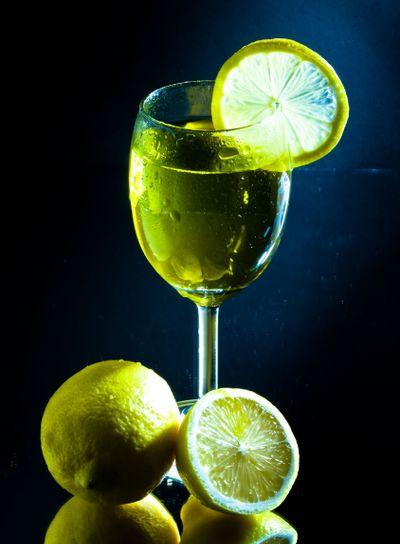 Glass of juice and lemon