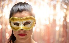 Caucasian woman wearing a carnival mask