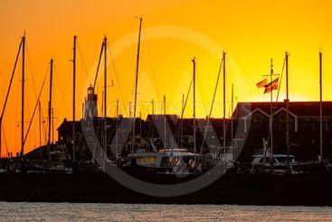 Sunset with skyline silhouet Urk, Dutch fishing village