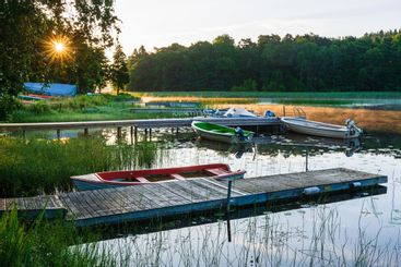 Jetty and boats on river, Mölnlycke, Västra Götaland,...