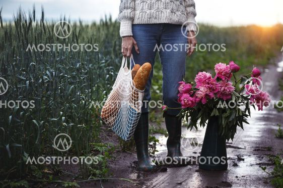 girl with a bouquet of flowers walking on a road