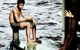 Boy on the docks, Brazil, Amazon