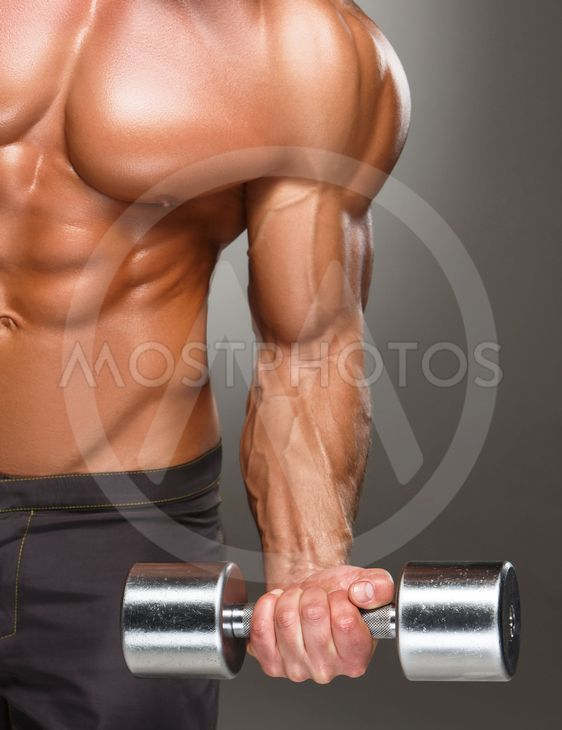 Closeup of a handsome power athletic man bodybuilder...
