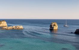 The yacht moored on the open sea (region of Epirus, Greece)