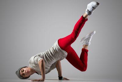 Young break-dancer doing handstand