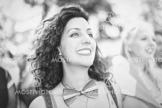 Black and white woman during the pride parade in...