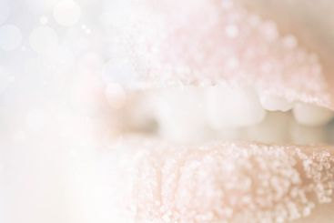 closeup beauty mouth with soft sugar coated lips