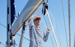 Young man on a sailboat