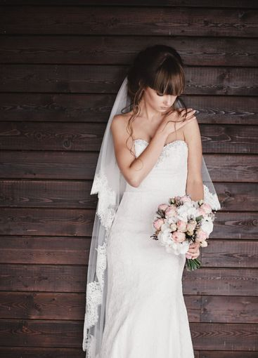beautiful young bride in a luxury white dress with a...