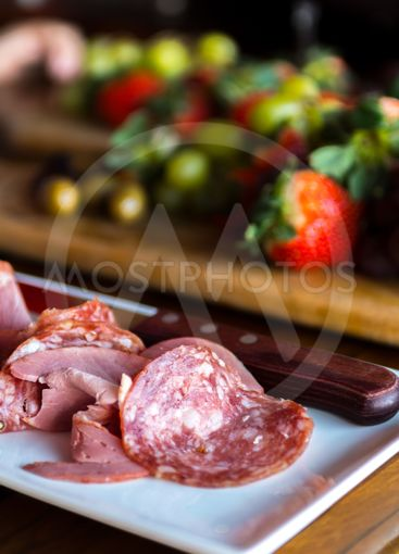 Spread of italian meat fruit and wine
