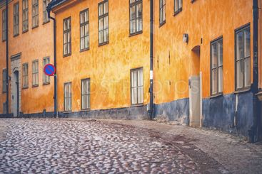 Old parts of Stockhom with cobblestones and orange old...
