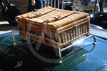 wicker suitcase on classic car