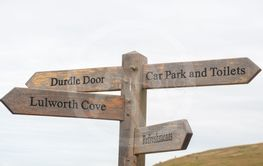Sign post to lulworth and Durdle door tourist attractions