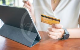 Online shopping with smartphone and shopping bags...