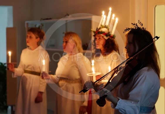 Lucia parade with singing girls and boys in white dresses...
