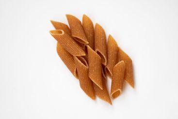 Raw, dark, whole grain pasta