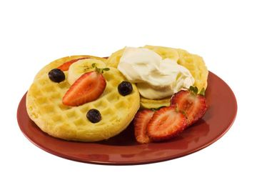 fruity waffles on a red plate