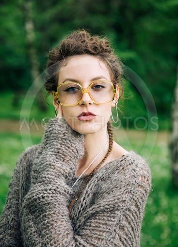 Pretty young woman with eyeglasses in the forest