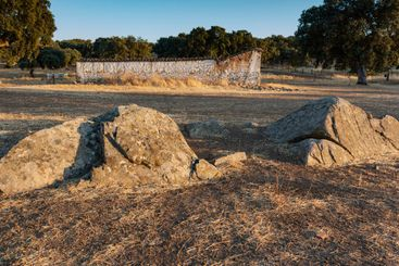 large stones on a farm at sunset